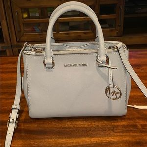 Micheal Kors purse in a light blue color